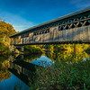 autumn scene covered bridge over Clay Brook