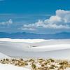 tobogganers on White Sands dunes