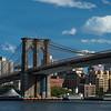 Watchtower sign visible beneath Brooklyn Bridge
