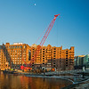 moon over Lovejoy Wharf with demolition crane