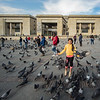 girl w pigeons in front of central courthouse Plaza del Bolivar Bogota