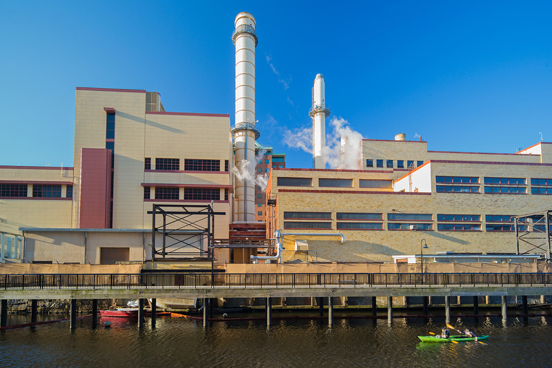 kayakers paddling past Kendall Cogeneration plant