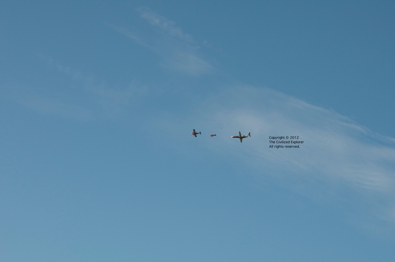 The middle plane is the Oracle aerobatic aircraft. I can't identify the other two.