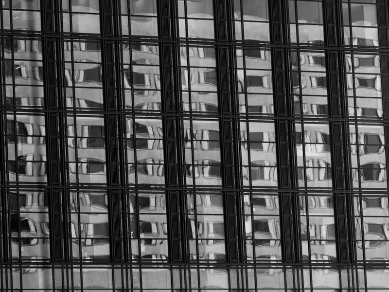 Window reflections on a building near Chinatown.