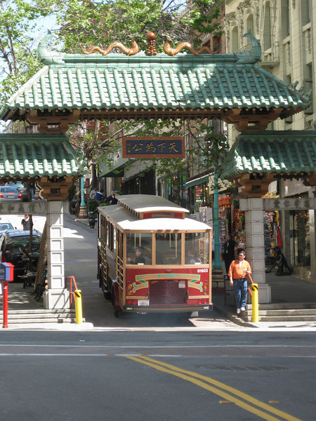 A sightseeing bus goes through the Chinatown gate