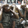 Hear no evil, see no evil, speak no evil on a sidewalk bench just south of Chinatown