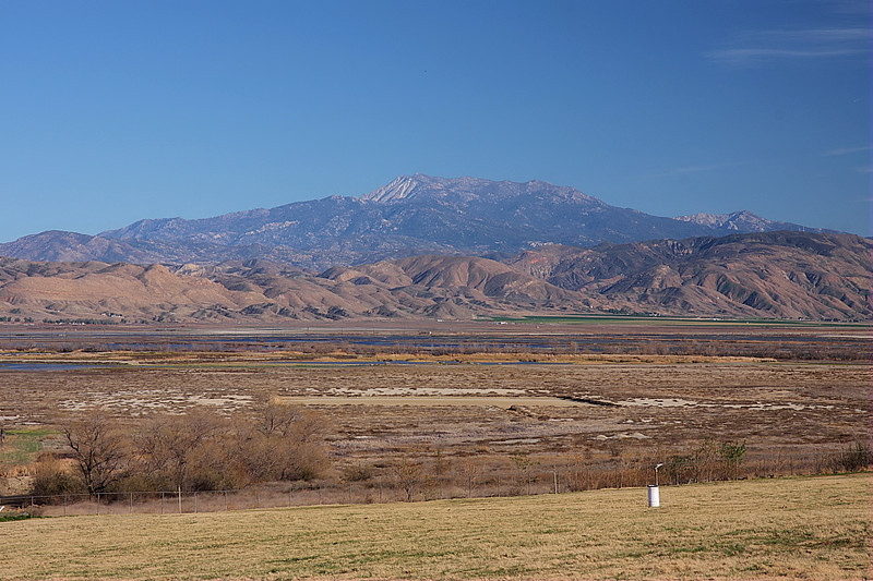 Here's the scene taken near the locked gate at the end of Davis Road looking out towards the San Jacinto Wildlife area and its ponds, with green farms off to the right and Mount San Jacinto standing sentinel in the background. This was taken on February 3, 2012.
