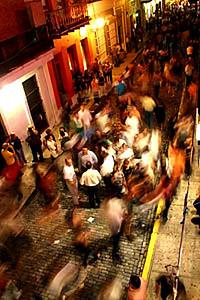 bustling city street at night in old San Juan