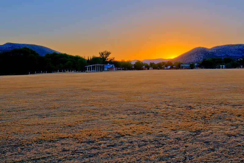 Sun setting over San Patricio, New Mexico polo field.