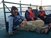 On the boat with Roso, the yellow Lab.