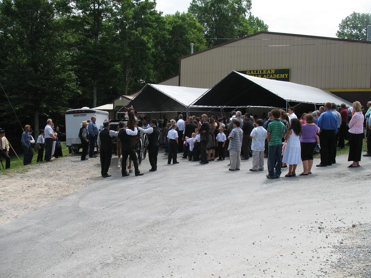 Loading casket in Hearse.
