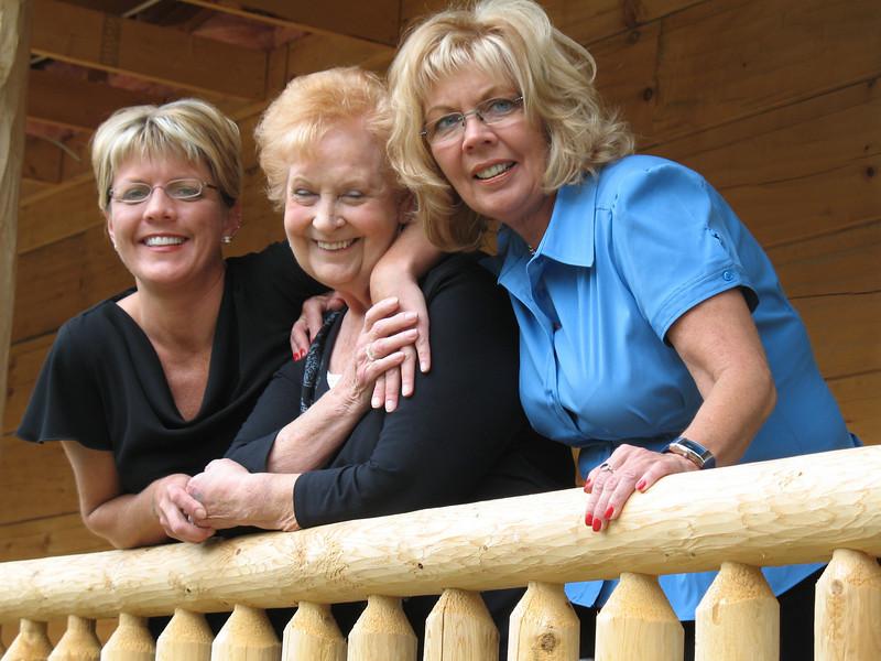 Heidi Tucker, Aunt Elaine and Debbie Tucker behind the cabin
