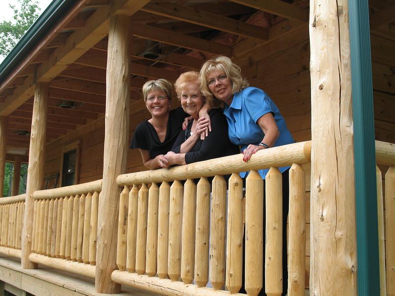 Heidi Tucker, Aunt Elaine and Debbie Tucker behind the cabin.