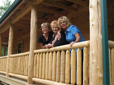 Heidi Tucker, Aunt Elaine and Debbie Tucker behind the cabin.