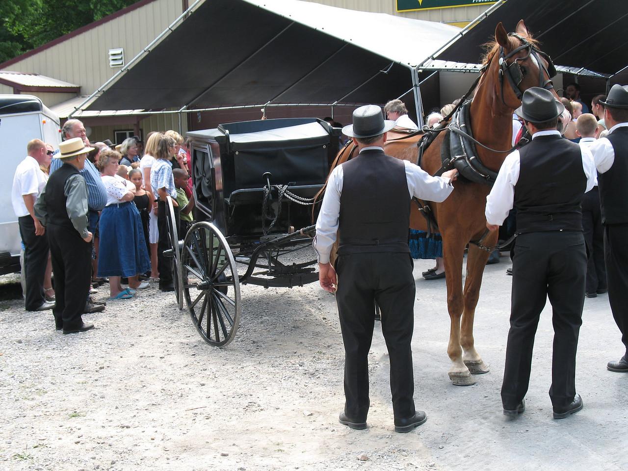 Loading casket in Hearse