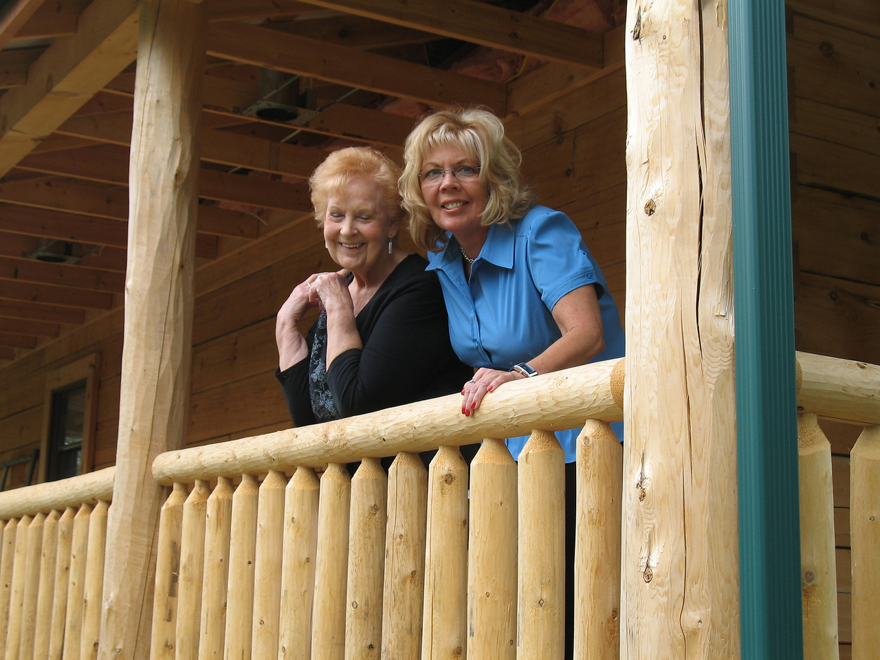 Aunt Elaine and Debbie Tucker behind the Cabin