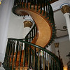 This is called the Miraculous Staircase, and it accesses the balcony in the Loretto Chapel.  It is built with no center support, and no nails, does two complete 360 revolutions.