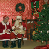 Santa amd Mrs. Claus take Christmas requests from Isabella Stonecipher