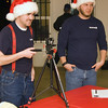 Chad Harvel and Jeff Windon with Key Peninsula Parks Department took pictures of the young ones and the red-clad visitors from the North Pole.
