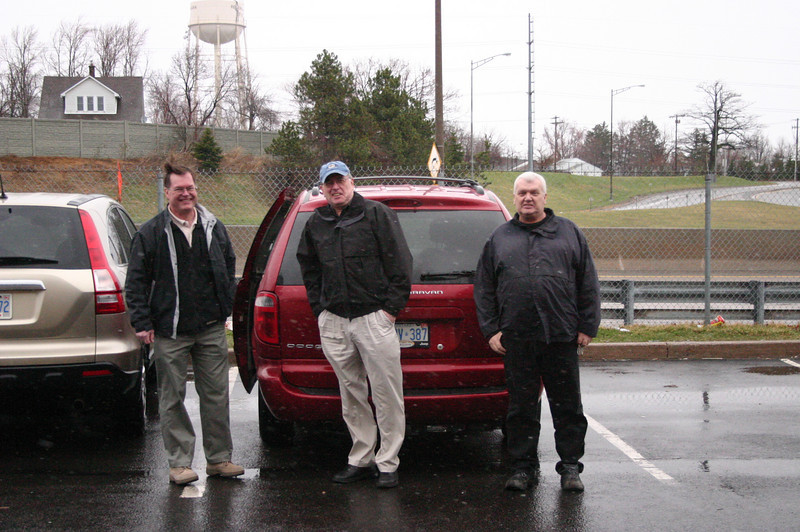"We left on the golf trip on Saturday, April 4, 2009.  Tom (centre) was up at 5:00 a.m.,picked up Phil (left) at 6:00 a.m., Al (right) at 6:30 a.m. and Greg ten minutes early at 6:50 a.m.   After the famous ""border incident"" we crossed the border into the U.S. at Buffalo at around 9:00 a.m. This photo was taken when we stopped for lunch outside Pittsburgh at a McDonalds.  The weather was damp, cool and windy."
