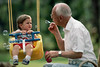 CO5 Choice 7 of 7 <br />  Great Grandfather Blowing Bubbles for His Great Grandson --- Image by © Bob Krist/CORBIS
