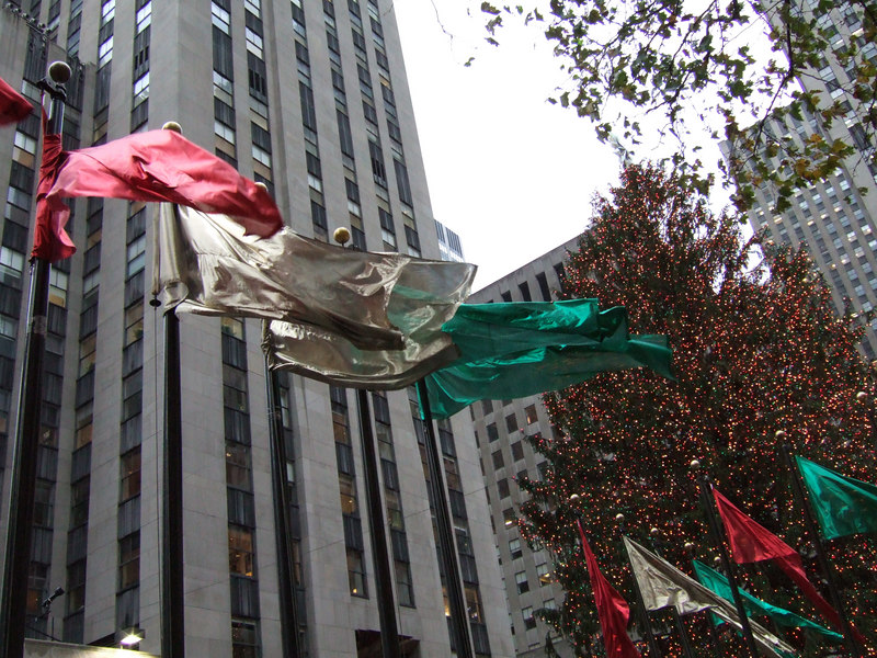 Flags blowing in front of the Rockefeller tree.