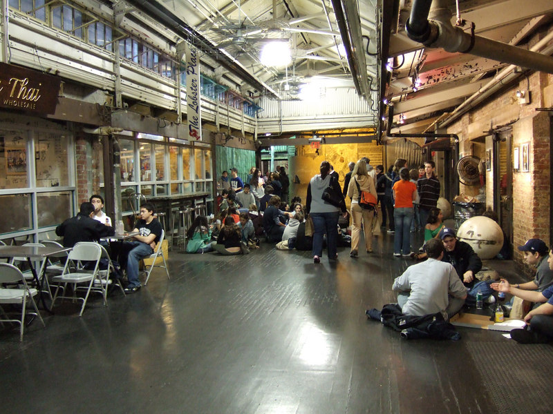 The local junior high and high schools have an open campus during lunch.  At 11am the Chelsea Market was swarming with kids.  Here they are on sitting on the floor to eat.
