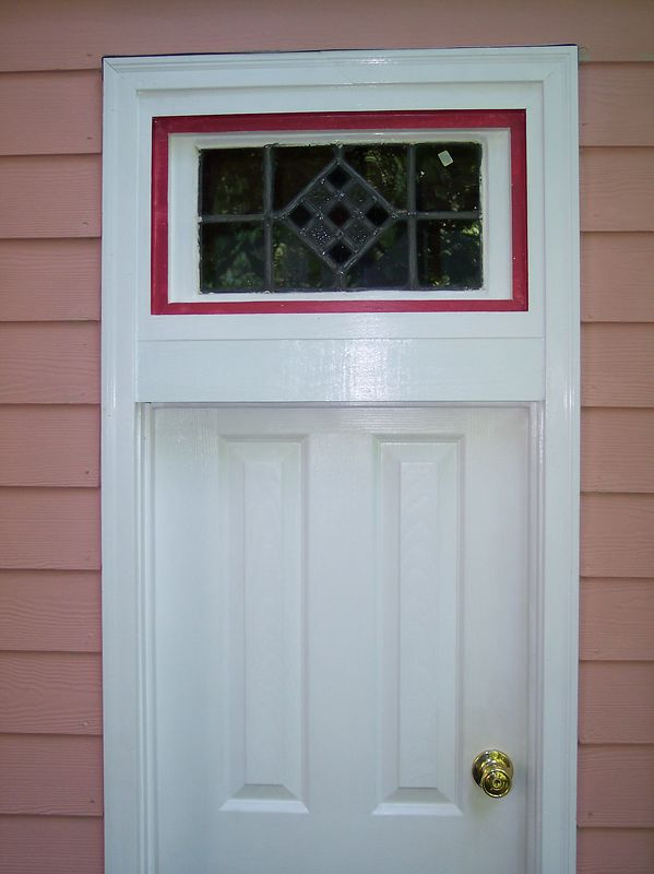 Stained glass window in transom over door.