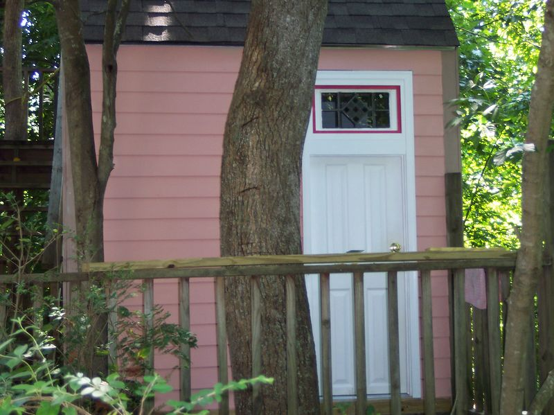 Side view with door and stained glass transom.