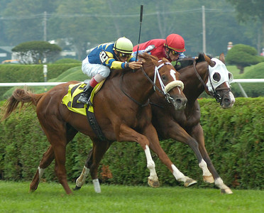 Cookram Rock and John Velazquez (12) head for a narrow victory over City Sneakers and Ramon Dominguez in Friday's 4th race. Ed Burke 9/3/10