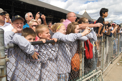 Young fans root for their horses to win while wearing their new long sleeve t's on a chilly day at the track sunday. Photo Eric Jenks 9/5/10