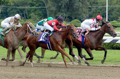 Come a Calling, ridden by Channing Hill (inside), wins the 7th race at the Saratoga Race Course Monday afternoon. Photo Erica Miller 9/6/10 spt_7thRace_Tues