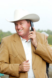 Trainer Larry Jones smiles as he calls his wife after he won the Woodward Stakes, Grade 1, with Havre de Grace on Saturday at the Saratoga Race Course. Photo Erica Miller 9/3/11 spt_Woodward3_Sun