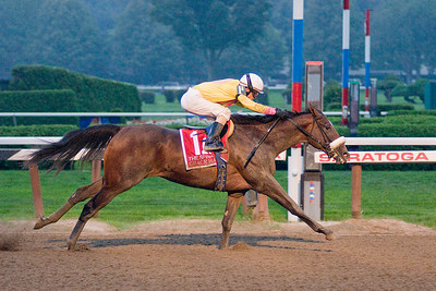 Ramon Dominiguez crosses the line on a charging Grace Hall during the 120th Running of the Spinaway sunday evening. Photo Eric Jenks 9/4/11