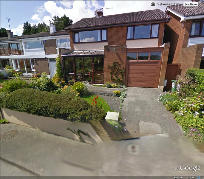 Josie Moran Hallinan from GoogleEarth in her conservatory.<br /> <br /> This is a Google Map (Earth) photo taken of my sister Josephine's (Josie's) house in Killiney Co. Dublin, Ireland. My sister can be seen sitting in her conservatory. This photo was taken while Google was mapping streets in the area. What is truly amazing about this photo and other Google Map photos that follow is that of the seven (7) Moran siblings three of us were captured on Google Maps (Earth). The likelihood of that happening is billions to one.<br /> <br /> The other photos that this statement will be added to are:<br /> ---Another of Josephine from a slightly different angle.<br /> ---A photo of my brother Matthew (Matt) taken by GM in Co. Kildare Irl.<br /> ---A photo of yours truly (Mike Moran) sitting on a stone wall accompanied by my two collies in Milton MA.