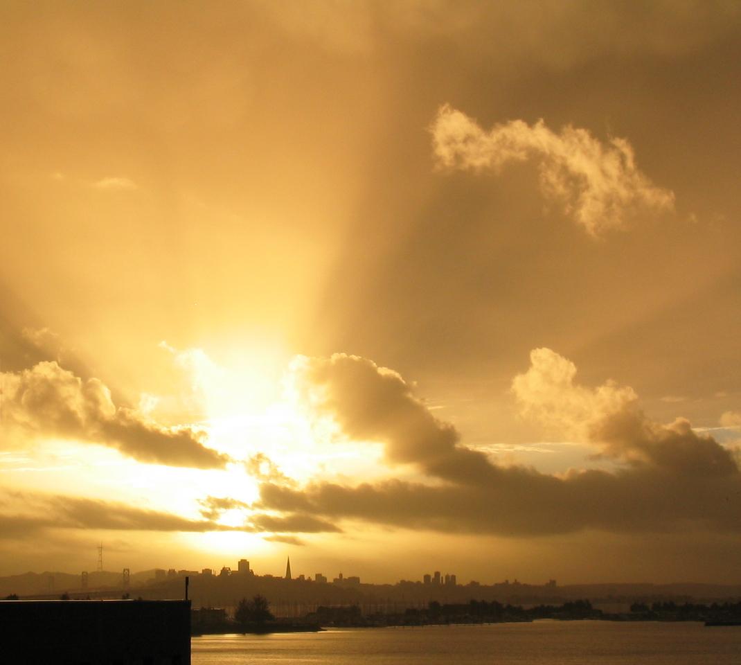 Gold sunrays from EmeryBay balcony - credits box & water