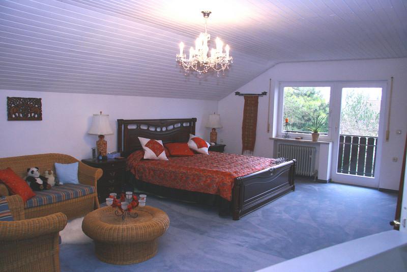 Main bedroom with door to balcony