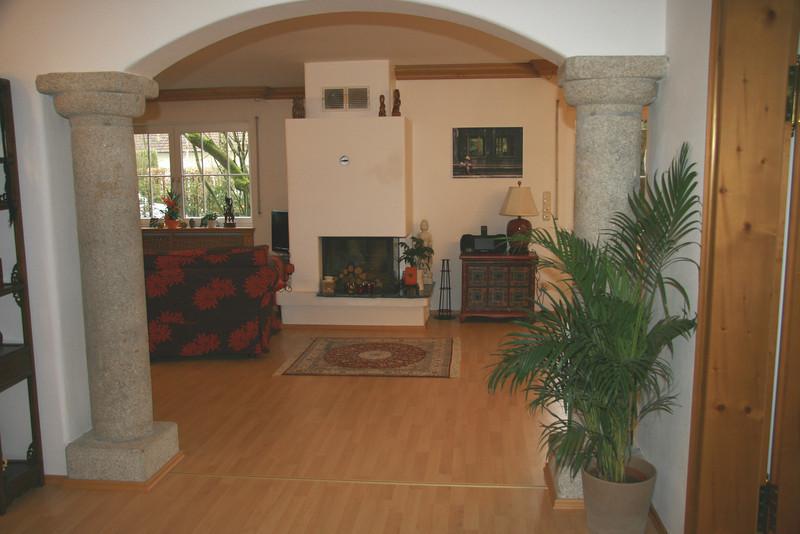 Stone pillars leading to living room