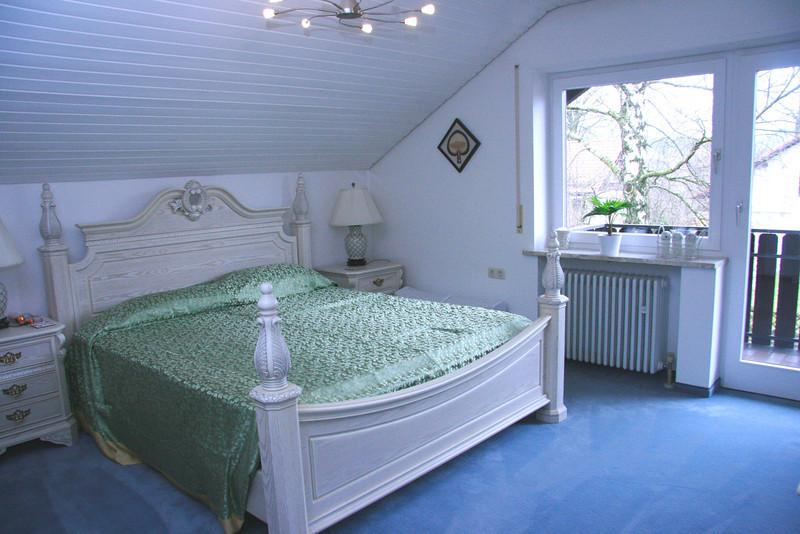 Guest bedroom with door onto balcony