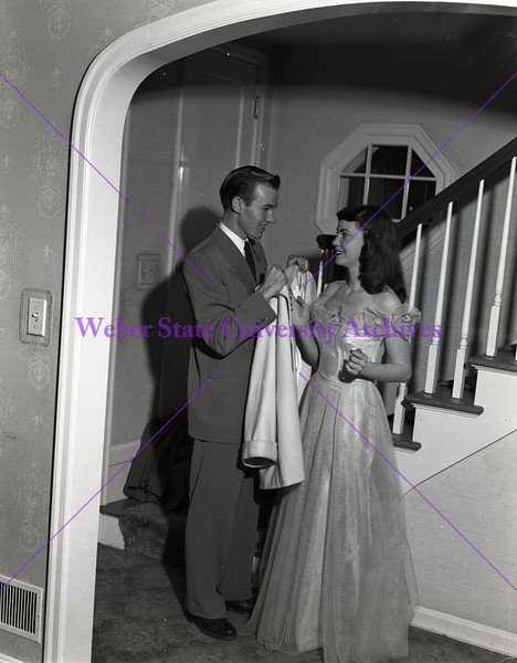 Couple preparing to go to a dance - 1947