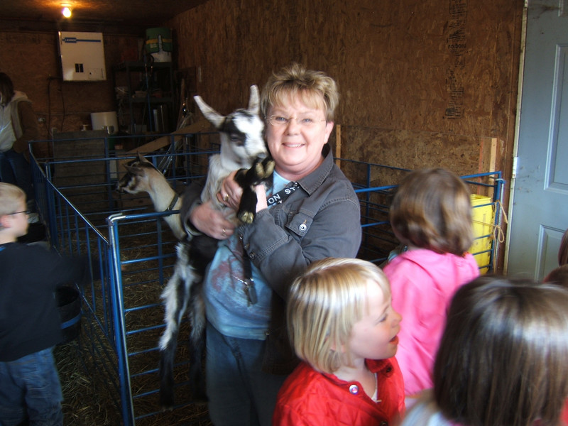 April 20, 2007: Linda and her students on a fiedl trip to the hobby farm of a co-worker. Linda is holding an Alpine kid.