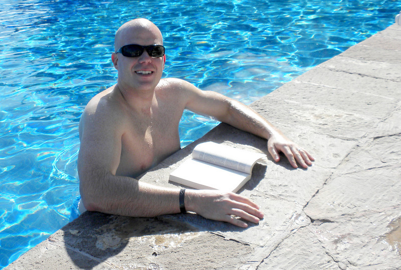 Daddy reading his book in the pool