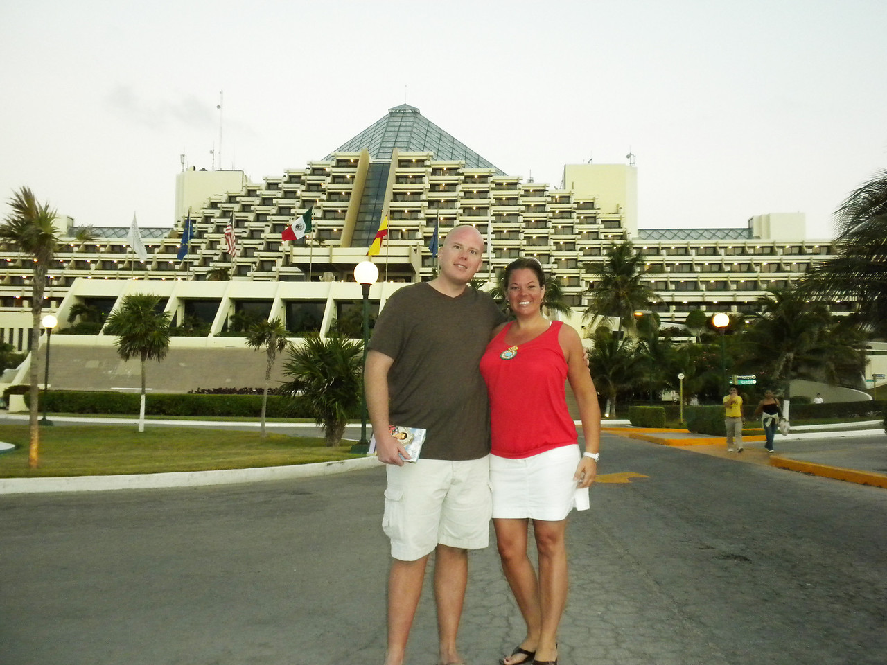 Daddy and Mommy in front of our hotel (Grand Melia), waiting for the city bus to take us to the store.