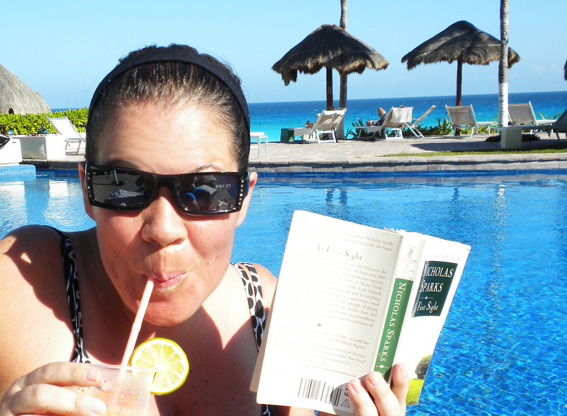 Mommy sipping on her yummy drink (v. Mango Tango...MMMM...MMMMM) and reading her book by the pool