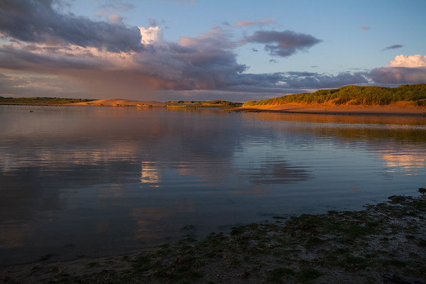 Setting sun lighting the northern dunes, Ythan Estuary.