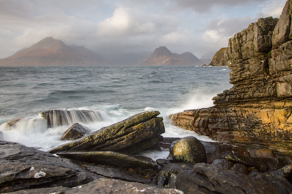Cornish' boulder - view to the Cuilin on a stormy day at Elgol, Isle of Skye.
