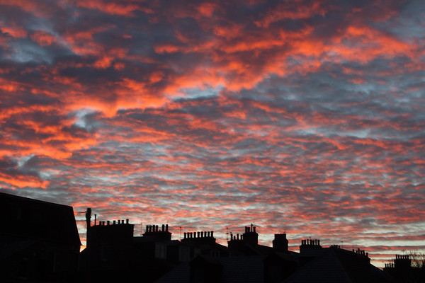 Sun set over Aberdeen; the chimneys of Westburn Road .
