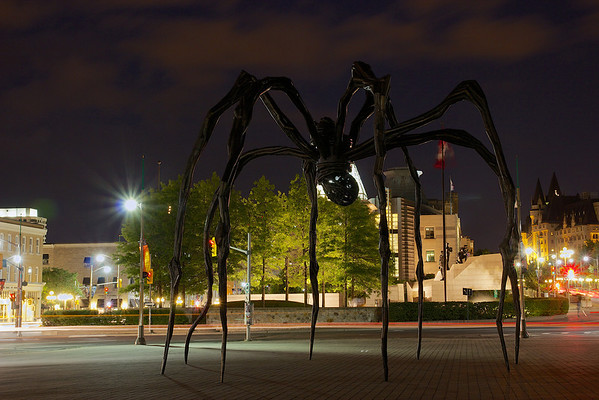 Maman, a sculpture by the artist Louise Bourgeois, stands in front of the National Art Gallery. It measures over 30ft high and over 33ft wide, with a sac containing 26 marble eggs.