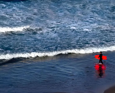 Red surf board - blue sea - surfer is steps away from an evening wave - Dana Point, California.  Order now or email me for signed copy and ordering instructions.
