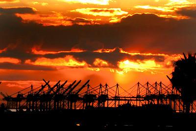 Harbor with cranes at dawn